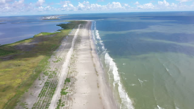 a view of the newly restored caminada headland a 13milelong barrier island system that buffers the louisiana coast from tropical storms and surge... - 復元する点の映像素材/bロール