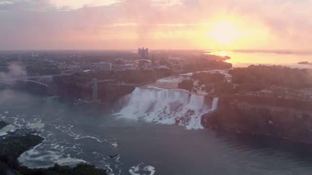 view of the niagara falls(bridal veil falls) in newyork, usa at sunrise - wide stock-videos und b-roll-filmmaterial