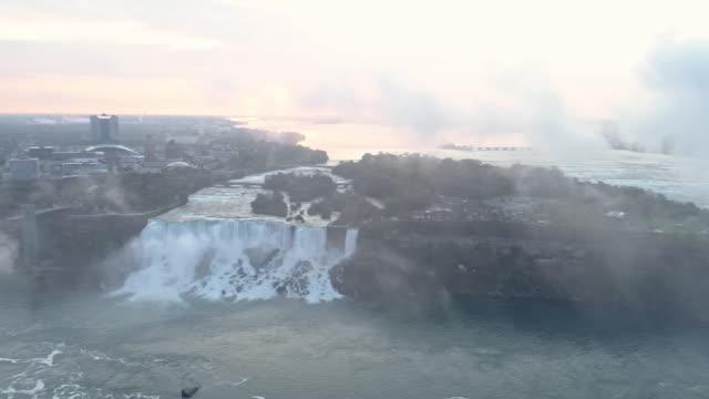 View of the Niagara Falls(Horseshoe Falls and Bridal Veil Falls) in Ontario, Canada and in NewYork, USA at sunrise