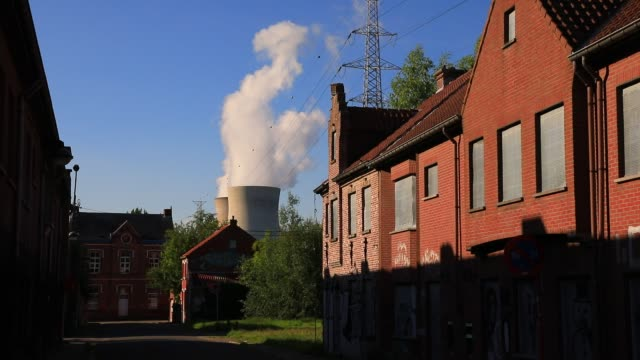 view of the nuclear power plant from the ghost village of doel on july 13, 2020 in beveren, belgium. wedged between the second port in europe,... - western european culture stock videos & royalty-free footage