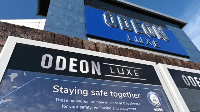 view of the odeon sign on the odeon cinema at the quay on october 6 in glasgow, scotland. odeon cinemas are cutting the opening hours for some of its... - odeon cinemas点の映像素材/bロール