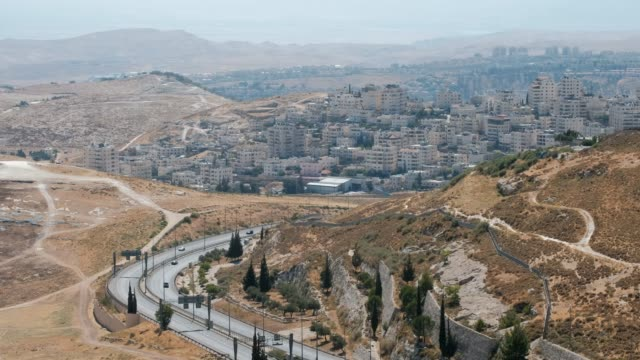 june 25: view of the palestinian village of az-za'ayyem or al-zaim east of jerusalem's municipal borders, across highway 1, the main road connecting... - palestinian stock videos & royalty-free footage