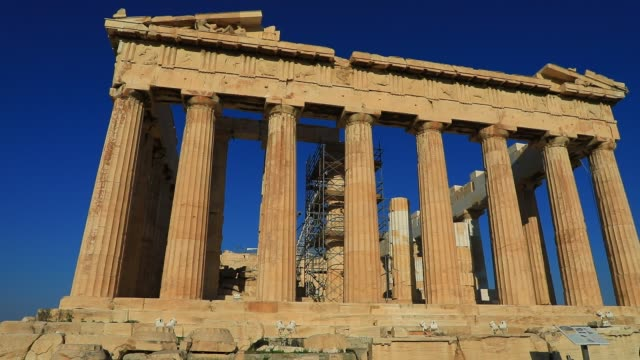 view of the parthenon temple with no visitors around, as background a blue sky at the acropolis on august 23, 2020 in athens. during the coronavirus... - greece stock videos & royalty-free footage