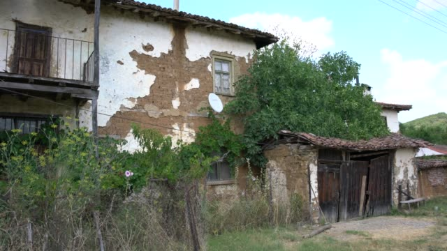 view of the partially ruined, sericulture, adobe and brick house, typical for the region of byala river valley in eastern rhodope mountains, bulgaria - brick house stock videos & royalty-free footage