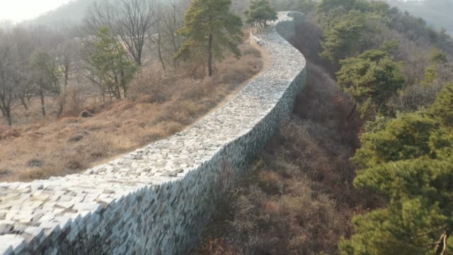 view of the pasaseong stone wall(t is said that the fortress was constructed during the reign of the king pasa, the 5th ruler of the silla kingdom) in yeoju-si - surrounding wall stock videos & royalty-free footage