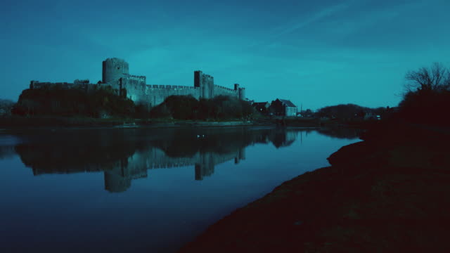 ws a view of the pembroke castle at night / pembroke, wales, united kingdom - pembroke stock videos & royalty-free footage