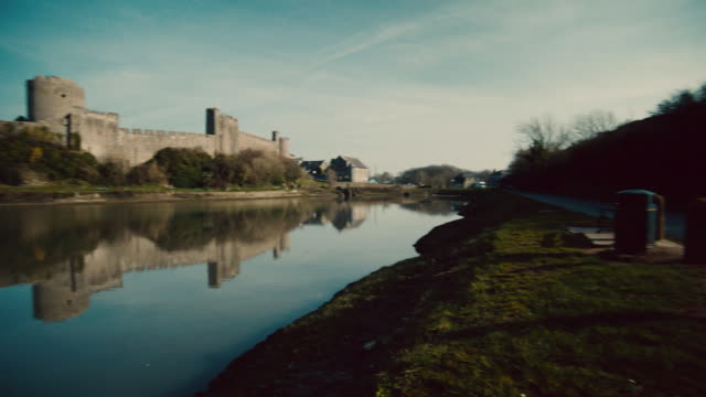 pan a view of the pembroke castle during the day / pembroke, wales, united kingdom - pembroke stock videos & royalty-free footage