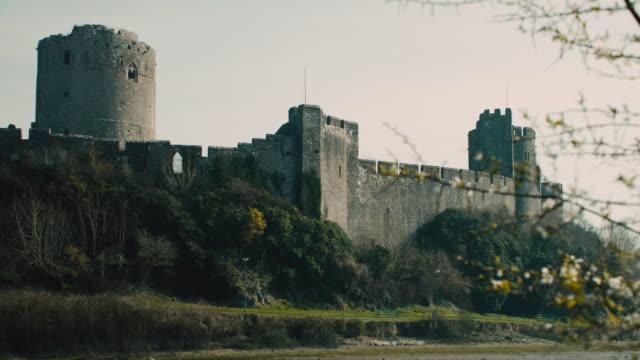 stockvideo's en b-roll-footage met tu a view of the pembroke castle / pembroke, wales, united kingdom - pembroke
