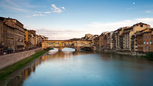 t/l ws view of the ponte vecchio and the arno river at sunset / florence, italy - florence italy stock videos & royalty-free footage