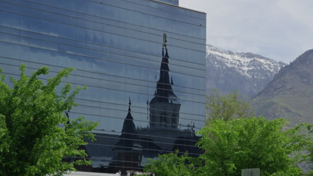 view of the provo city center temple reflecting in the nu skin building - nu stock videos & royalty-free footage