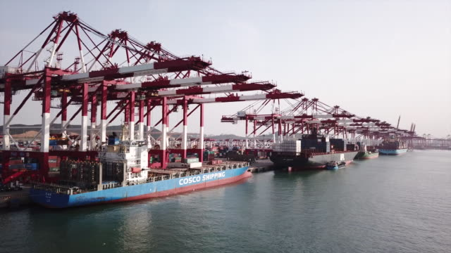 view of the qingdao new qiantan port in qingdao, china on monday, may 7, 2018. - crane stock videos & royalty-free footage