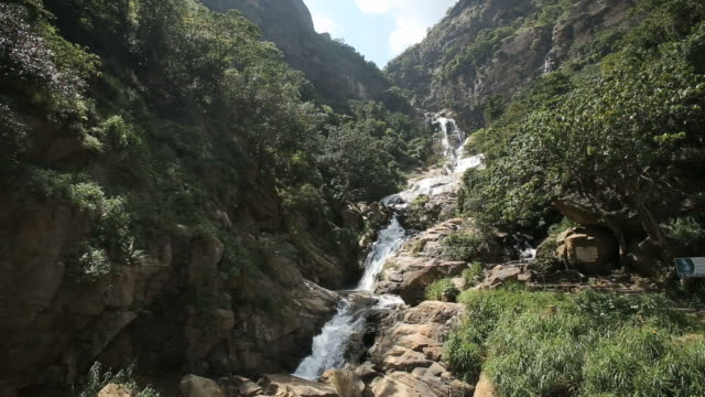 view of the ravana falls in ella.one of the widest falls in the country.  srilanka - sri lanka stock videos & royalty-free footage