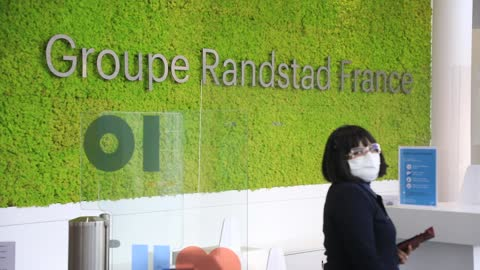 stockvideo's en b-roll-footage met view of the reception desk at the french headquarters of the randstad company on december 4 in saint-denis, france. dutch multinational human... - rubriekadvertentie