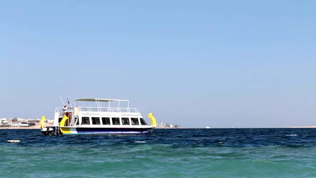 view of the red sea with a white ship. egypt. - red sea stock videos & royalty-free footage