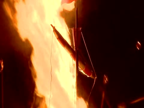 view of the replica viking galley's flagpole as it is catching fire during the up helly aa festival - バイキング点の映像素材/bロール