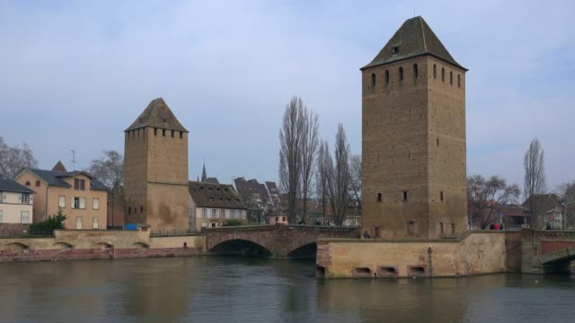 view of the river ill with ponts couverts, grande ile, unesco world heritage site, strasbourg, alsace, grand est, france, europe - circa 13th century stock videos and b-roll footage