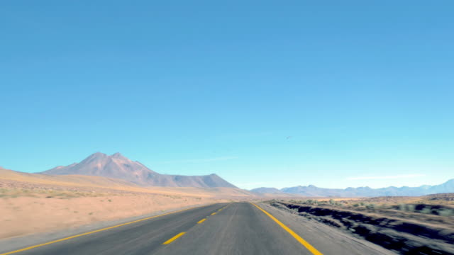 view of the road from inside the car while driving in the desert - car point of view stock videos & royalty-free footage