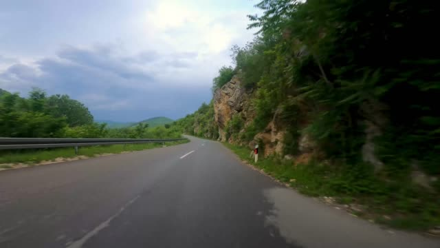 view of the road in the mountains and nature gopro cam - grass stock videos & royalty-free footage