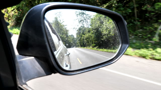 view of the road in the rear view mirror - wing mirror stock videos & royalty-free footage