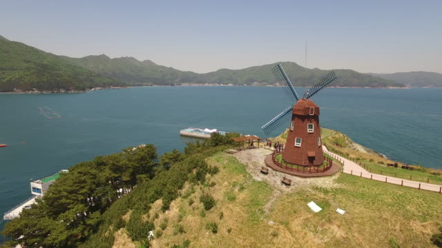 View of the sea and a windmill on Windy Hill in Goeje, Gyeongsangnam-do