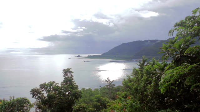 View of the sea and mountain with overcast sky