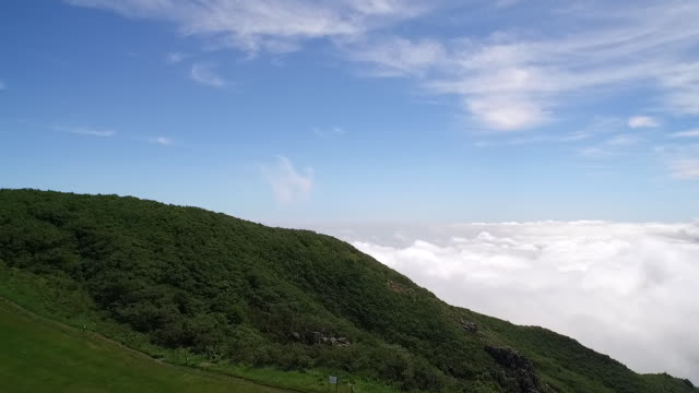 view of the sea of cloud and wind turbines on hill in seonjaryeong mountain - hill stock videos & royalty-free footage