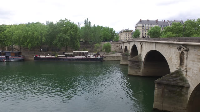 view of the seine pont marie and barges decked out on the quays of the voie georges pompidou under the quays of the hotel de ville april 28 2020 in... - hotel de ville paris stock videos & royalty-free footage