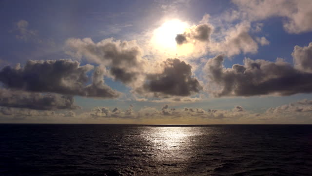 view of the setting sun over the pacific ocean from the deck of a cruise ship at sea - seascape stock videos & royalty-free footage