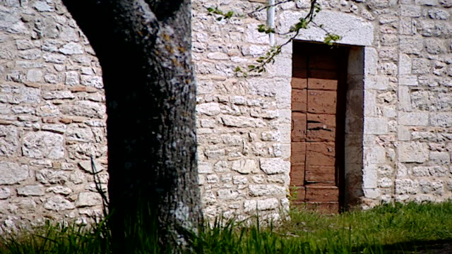 view of the side entrance of the medieval church of saint maron in volperino. during the crusades the relics of saint maron, founder of the maronite... - the crusades stock videos & royalty-free footage