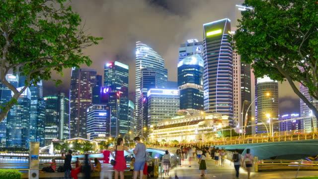 vídeos de stock, filmes e b-roll de vista sobre o horizonte da cidade de singapura cbd - porto distrito