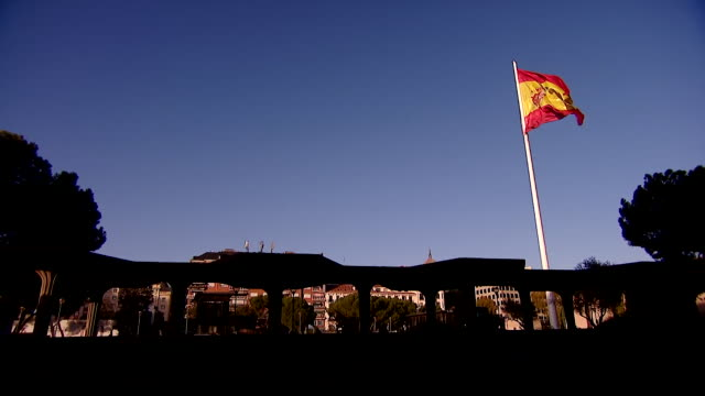View of the Spanish flag waving outside the Spanish parliament building