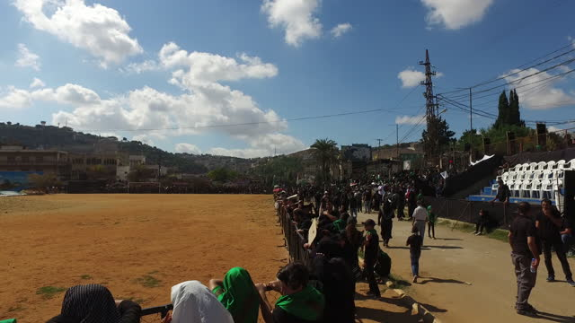 view of the sports field and audience waiting to watch the reenactment of the battle of kerbala at the ashura commemoration in nabatieh. ashura is... - ashura muharram stock videos & royalty-free footage
