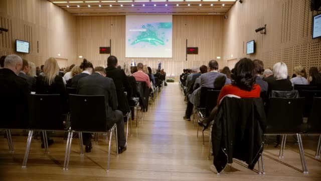 view of the stage during a seminar from the back of the conference hall - seminar stock videos & royalty-free footage