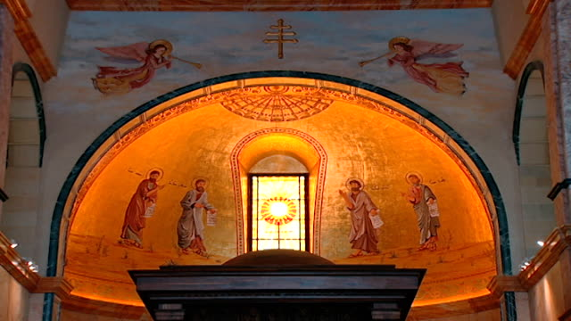 view of the stained glass window and fresco in the apse of the maronite cathedral of saint george, located in downtown beirut. the cathedral... - apse stock videos & royalty-free footage
