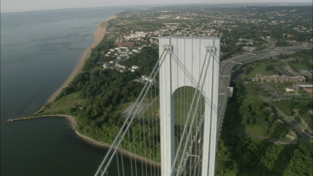 aerial pan view of the staten island end of verrazano-narrows bridge / staten island, new york, usa - staten island stock videos and b-roll footage