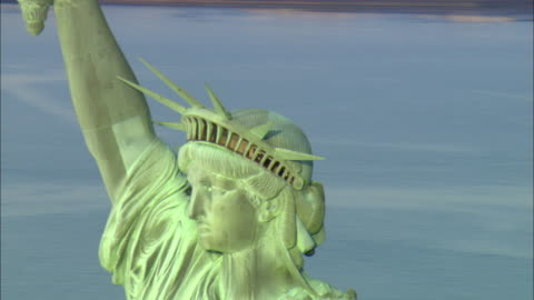 ms pan td zo view of the statue of liberty with manhattan skyline in background / new york city, new york, usa - statue of liberty new york city stock videos & royalty-free footage