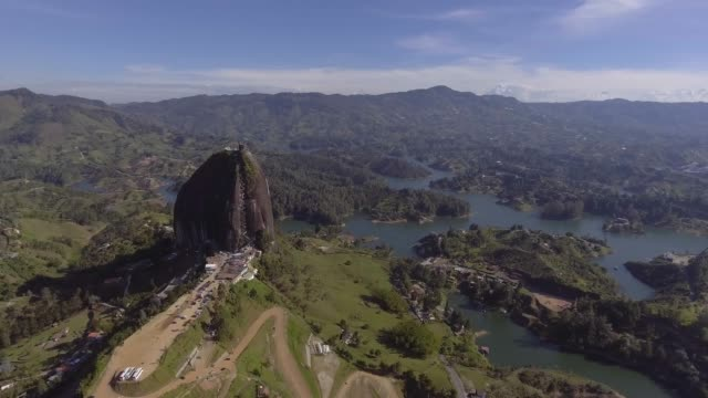 view of the stone, the guatapé peñol and the slopes of the small hills that surround it that look like islands. - peninsula stock videos & royalty-free footage