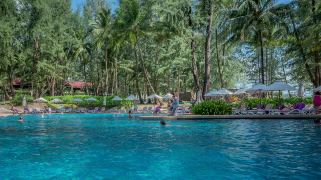 view of the swimming pool in phuket, thailand - infinity pool stock videos & royalty-free footage