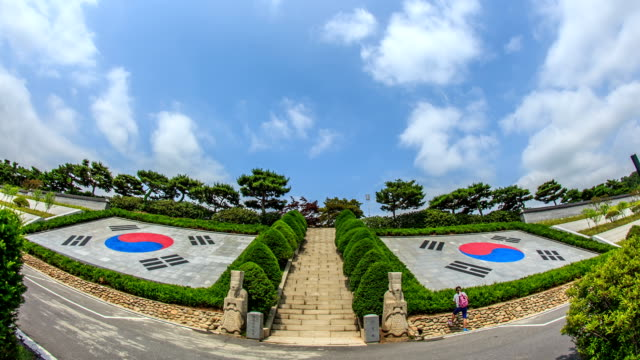 view of the taegeukgi (south korean flag) at the 'seoul national cemetery' - south korean flag stock videos & royalty-free footage