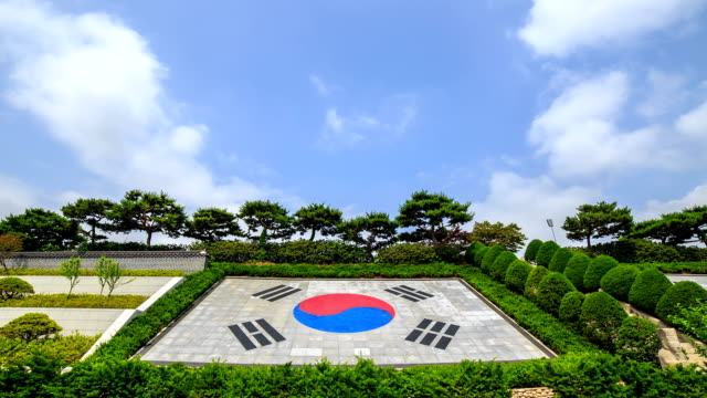 view of the taegeukgi (south korean flag) at the seoul national cemetery - south korean flag stock videos & royalty-free footage
