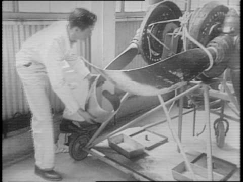 view of the tail of a nazi messerschmitt bf 109 taken down by british forces and sent to america for inspection / cockpit of plane / various angles... - drittes reich stock-videos und b-roll-filmmaterial