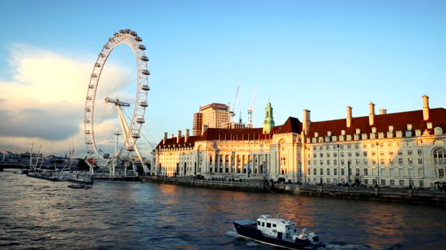 view of the thames river and the london eye (millennium wheel) in a beautiful sunset - millennium wheel stock videos & royalty-free footage