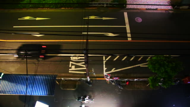 View of the tokyo street at night taken from elevated viewpoint with nice composition at night with traffic and people commuting.