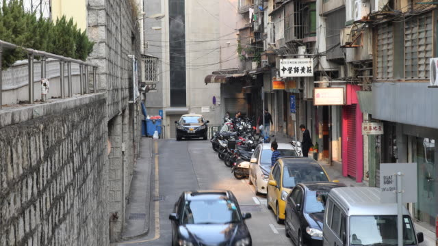 view of the traffic on a narrow one way side street. - one way stock videos & royalty-free footage