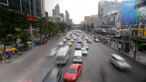 view of the traffics on the urban road in bangkok, thailand - traffic time lapse stock videos & royalty-free footage