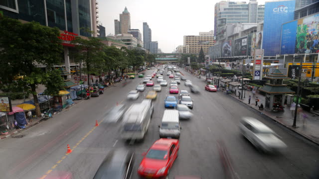 view of the traffics on the urban road in bangkok, thailand - thailand stock videos & royalty-free footage