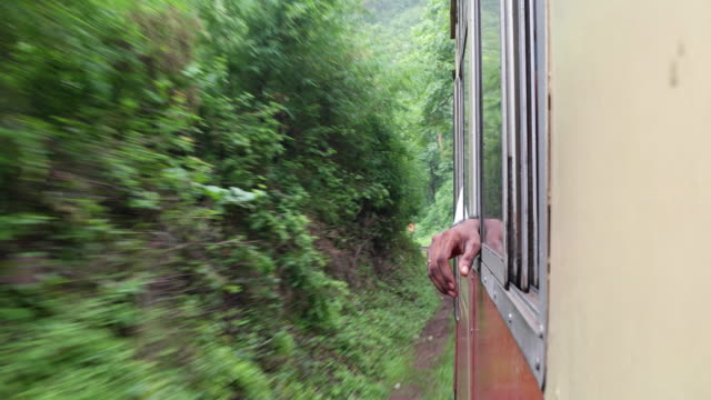 view of the train in hills with a hand hanging outside - british rail stock videos & royalty-free footage