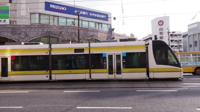 vídeos de stock e filmes b-roll de view of the tram moving in kyushu - linha do elétrico
