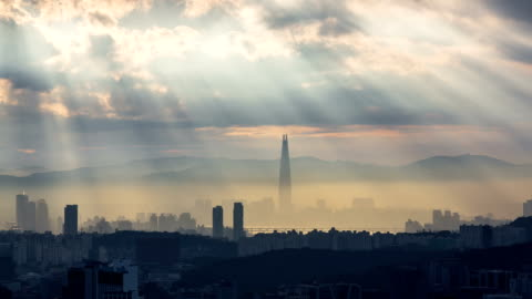 view of the tyndall phenomenon near han river and lotte world tower, seoul - dramatic sky stock videos & royalty-free footage