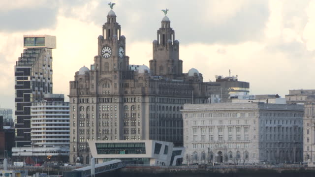 View of the Unity Residential Building, the Royal Liver Building, the ferry terminal and the Cunard Building in Liverpool, UK.